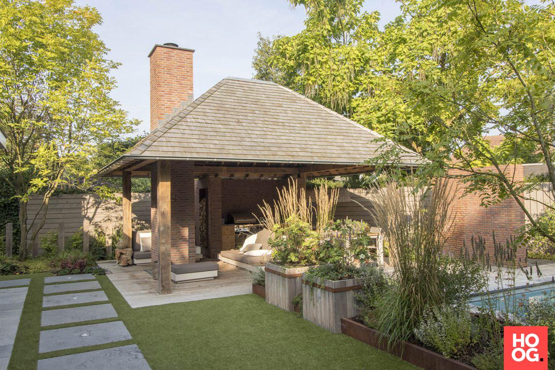 Van mierlo tuinen wellnesstuin met luxe overkapping hoog