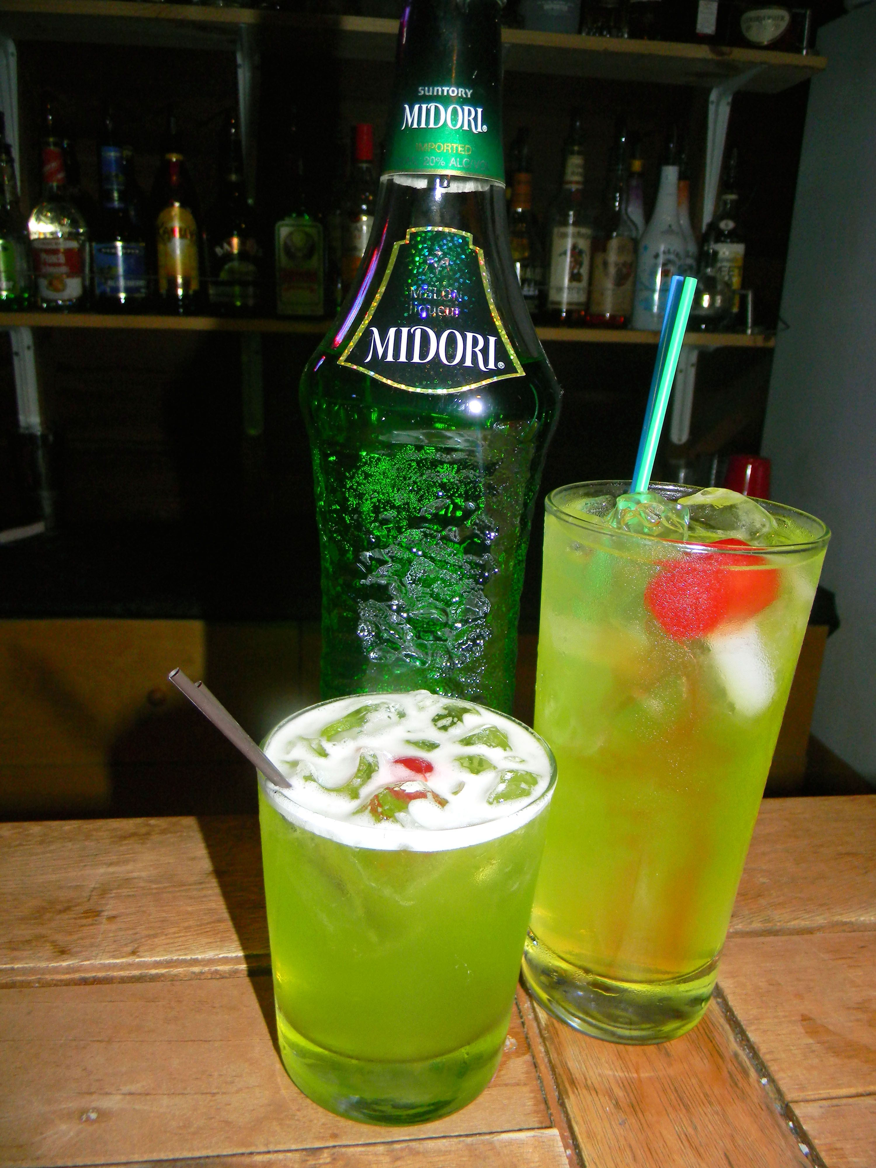 Midori Sour And Tokyo Tea Left To Right Spiced Rum Cocktails Rum Recipes Malibu Mixed Drinks
