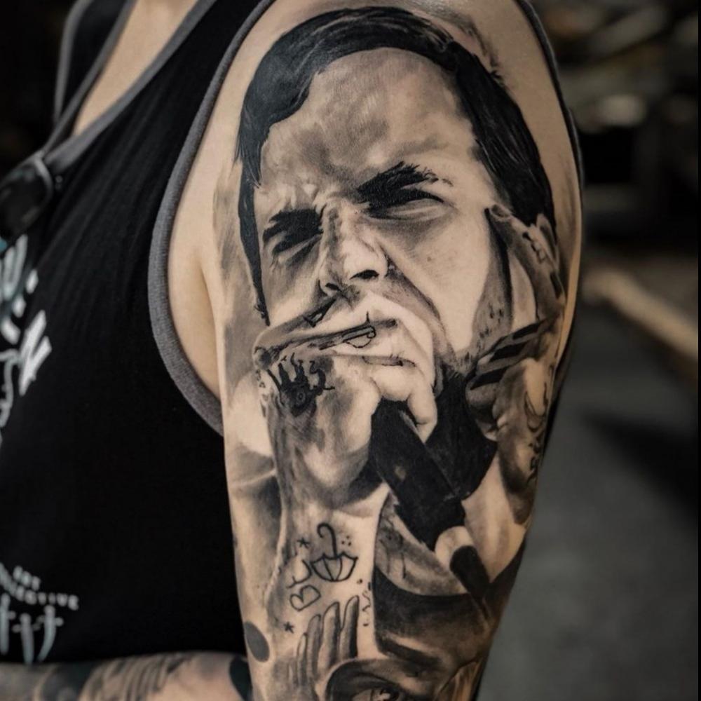 Black and grey portrait tattoo done by award-winning artist George Ninetynine. #portraittattoo #blackandgreyportrait #blackandgreytattoo #blackandgreyrealism #realismtattoo
