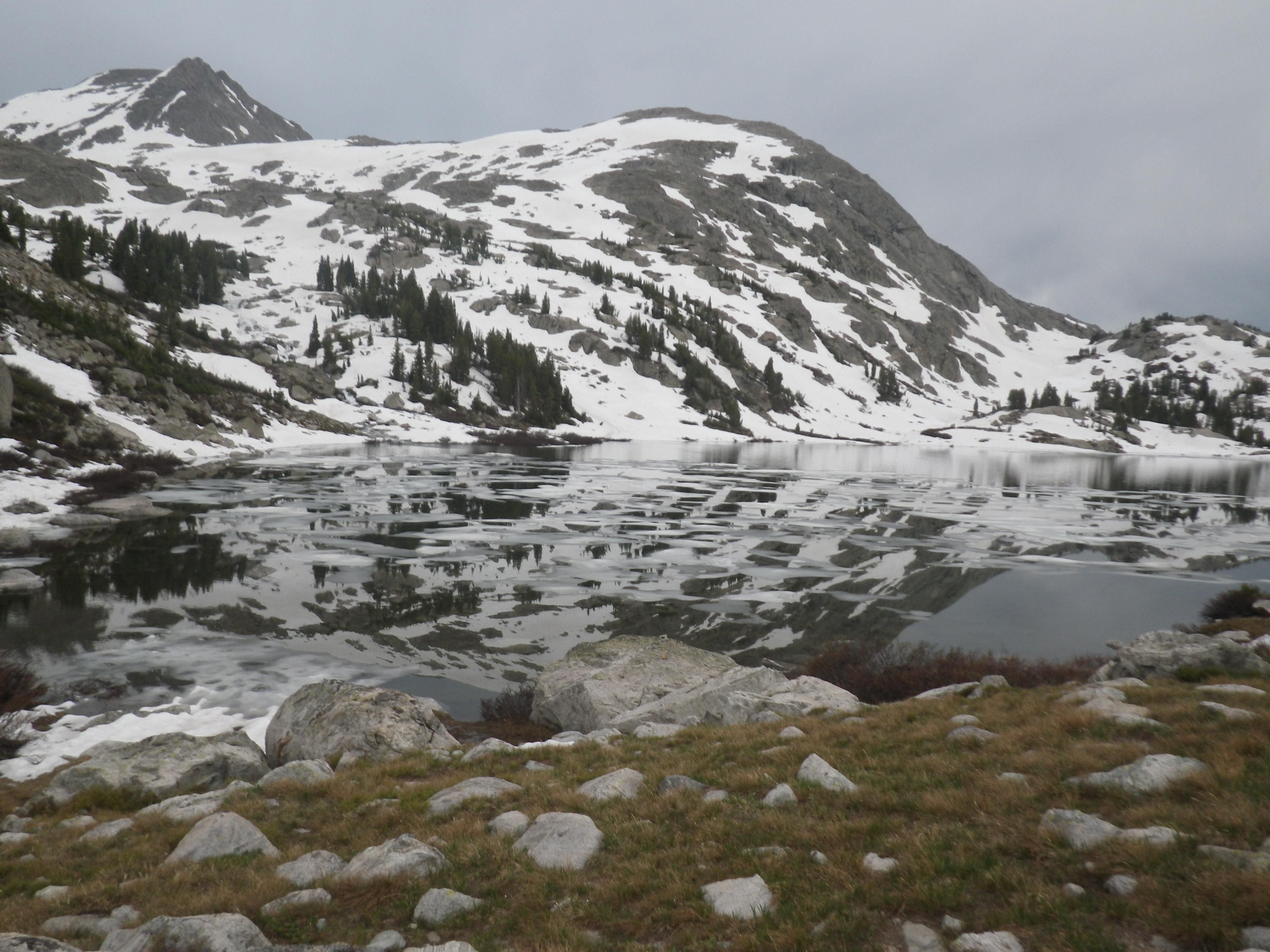 Hill reflecting off an icy lake, Northern Wind River Range, Wyoming. [4288 × 3216] - Nature and Science