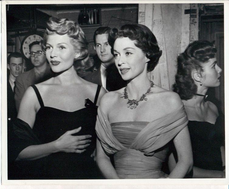 Lili Palmer attends a gala event with Rita Hayworth, Debbie Reynolds on right