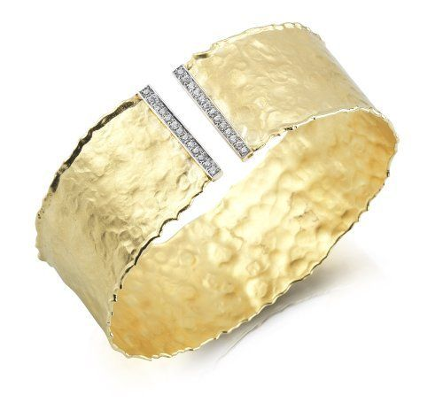I. Reiss 14K Yellow Gold Cuff Bracelet, Enhanced with Diamonds. I. Reiss. $6375.00. 14 Karat Gold. All items are shipped in the I.Reiss Gift Box. Hand-Crafted