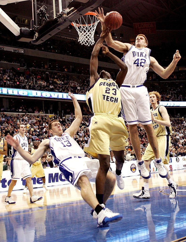 Lee Melchionni of the Duke Blue Devils takes a charge from