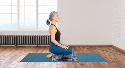 yoga student practicing hero pose sanskrit name virasana