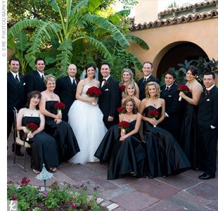 Bold red roses added a splash of color to the bridal party\'s ...