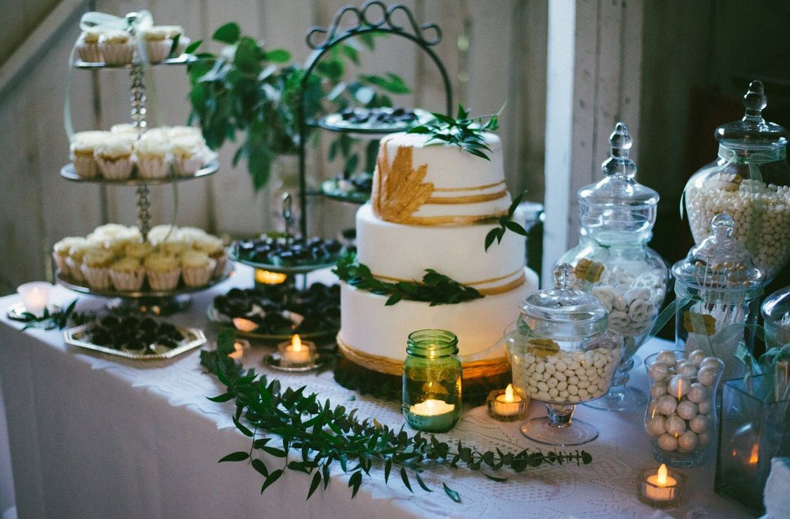 Dessert table with cupcakes homemade white and gold cake candy bar