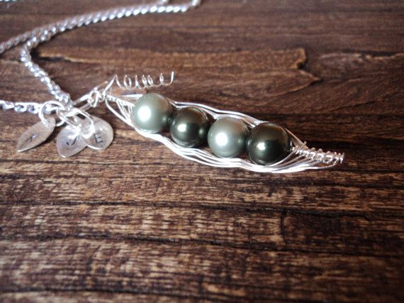 LOVE the peas in a pod jewelry from Etsy. Might need to get one when my pod is full.