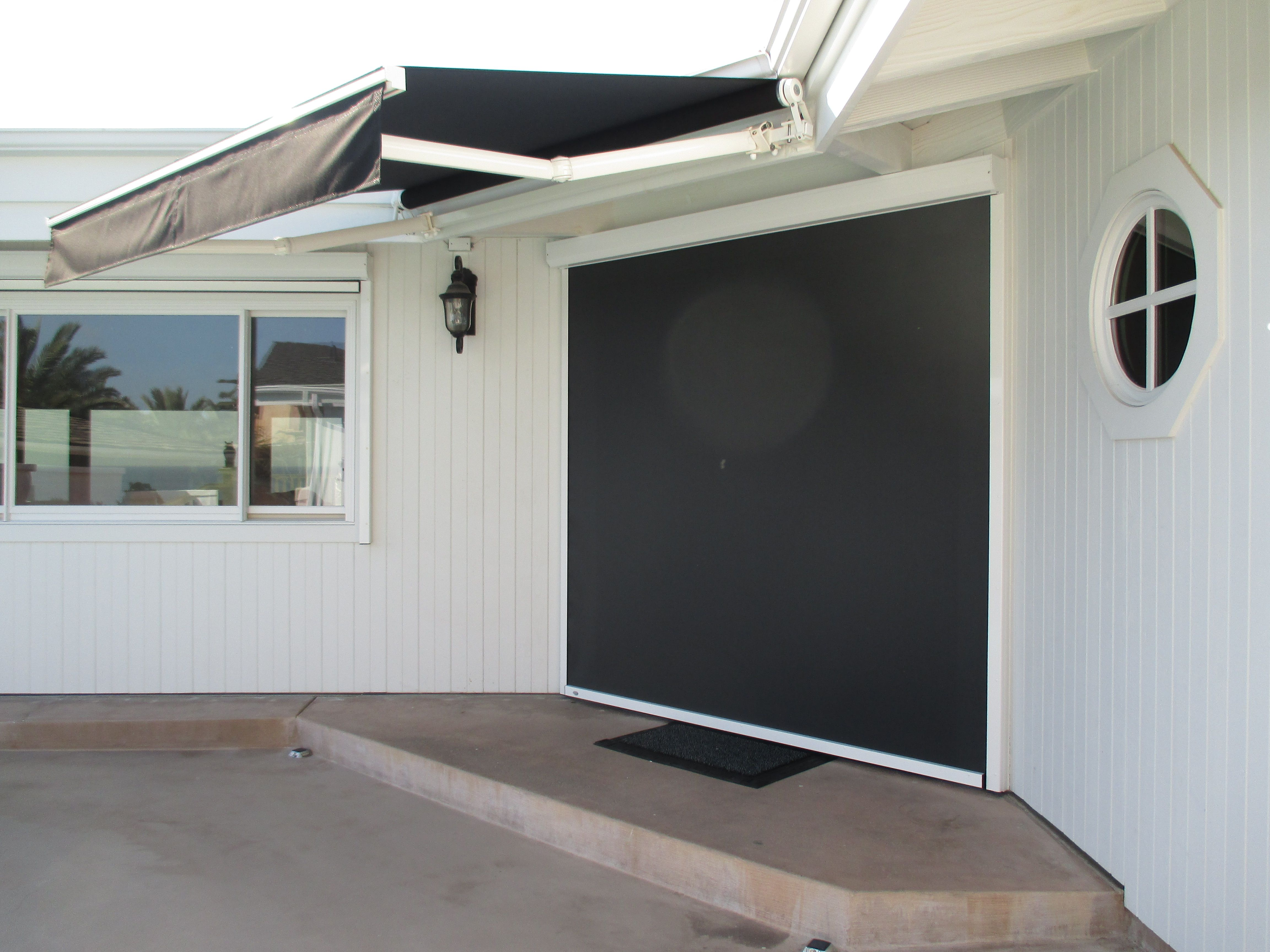 Retractable Awning & Retractable Motorized Power Screen installed
