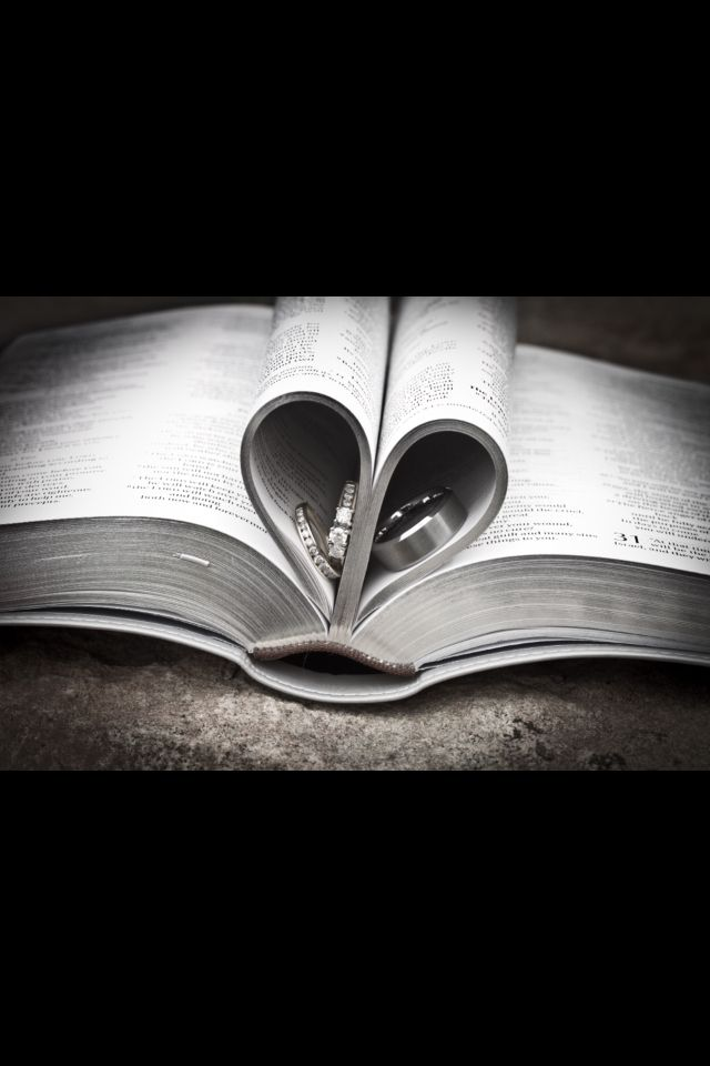 #Wedding Rings in Bible pages shaped like a heart
