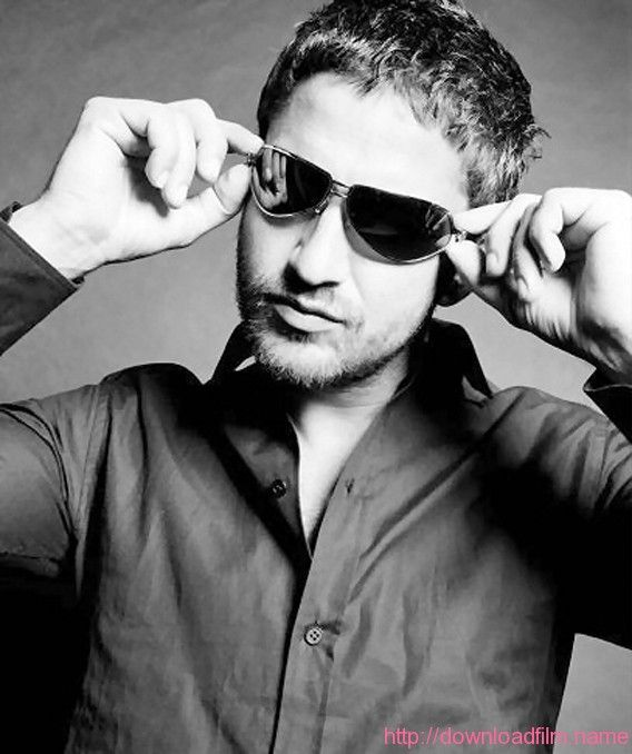 Gerard Butler and his sexy glasses.