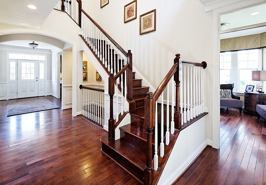 brown railings and white spindles define an elegant staircase the colby plan built by brookfield residential at saranac at lake manassas - Brookfield Homes Floor Plans