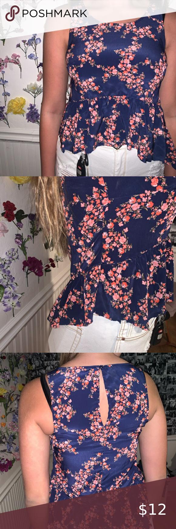 Photo of Tank top Floral, tank top, little ruffle on bottom, navy blu…