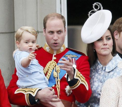 Britain`s Prince Willian holds Prince George as he waves with Catherine, the Duchess of Cambridge on the balcony at Buckingham Palace after attending the Trooping the Colour ceremony at Horse Guards Parade in central London