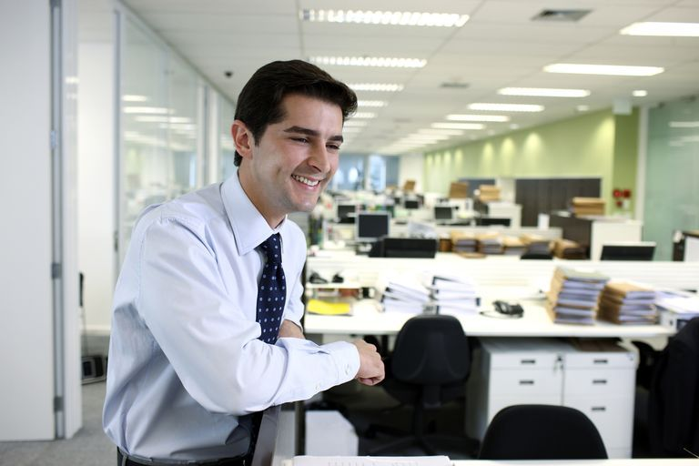 young lawyer leaning on cubicle