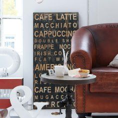 leather chair and coffee sign