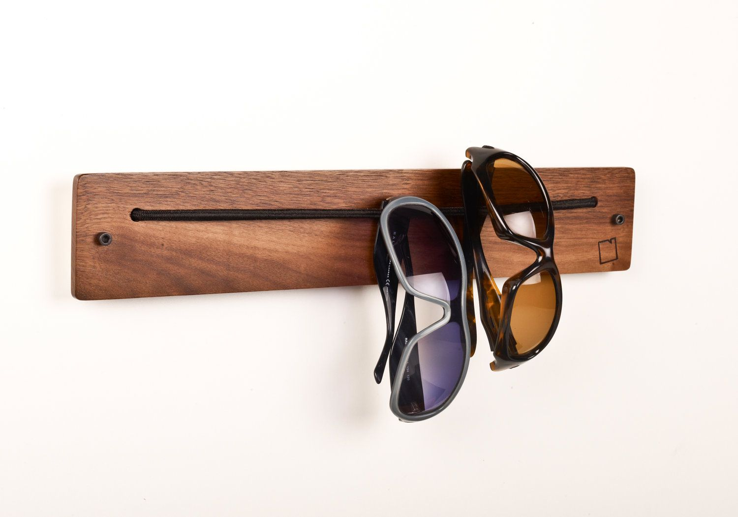 eyewear storage-I'm sure it's be easy to make (bungee chord and wood)