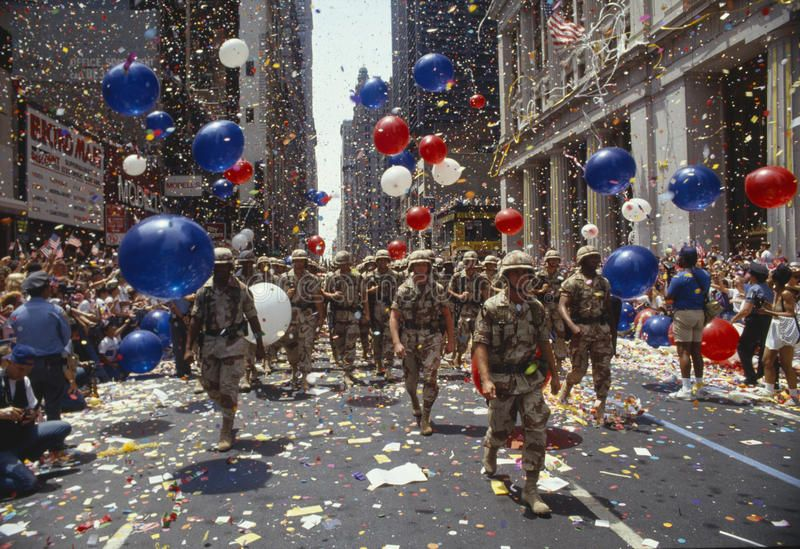 Soldiers marching in ticker tape parade, NY. Soldiers