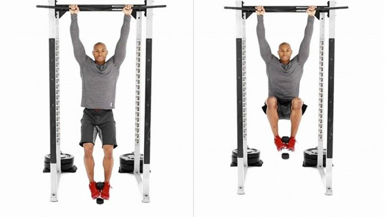 Hanging leg raises with added weight