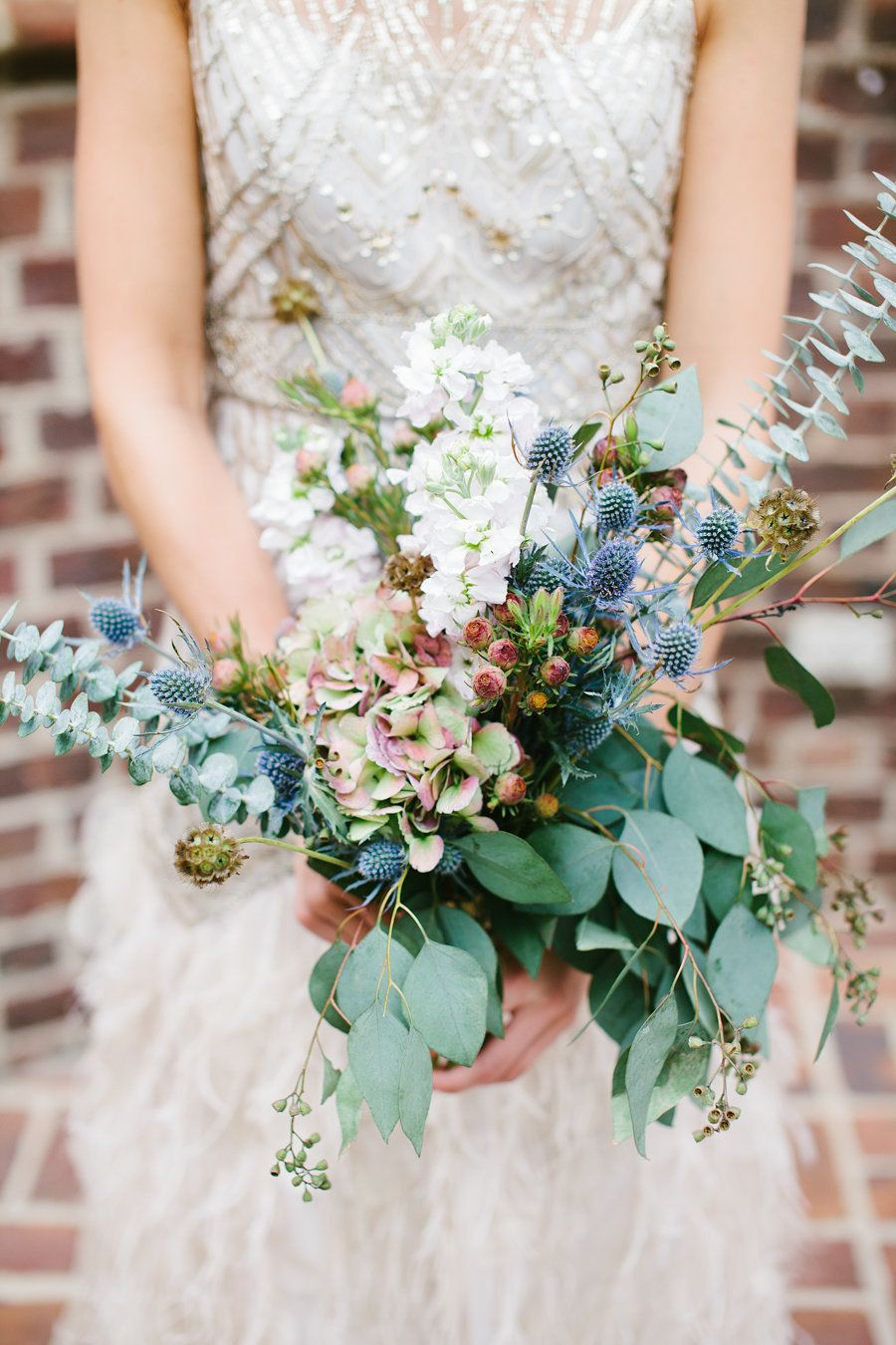 Bouquet with dusty blue accents by lily beeus sparkly wedding