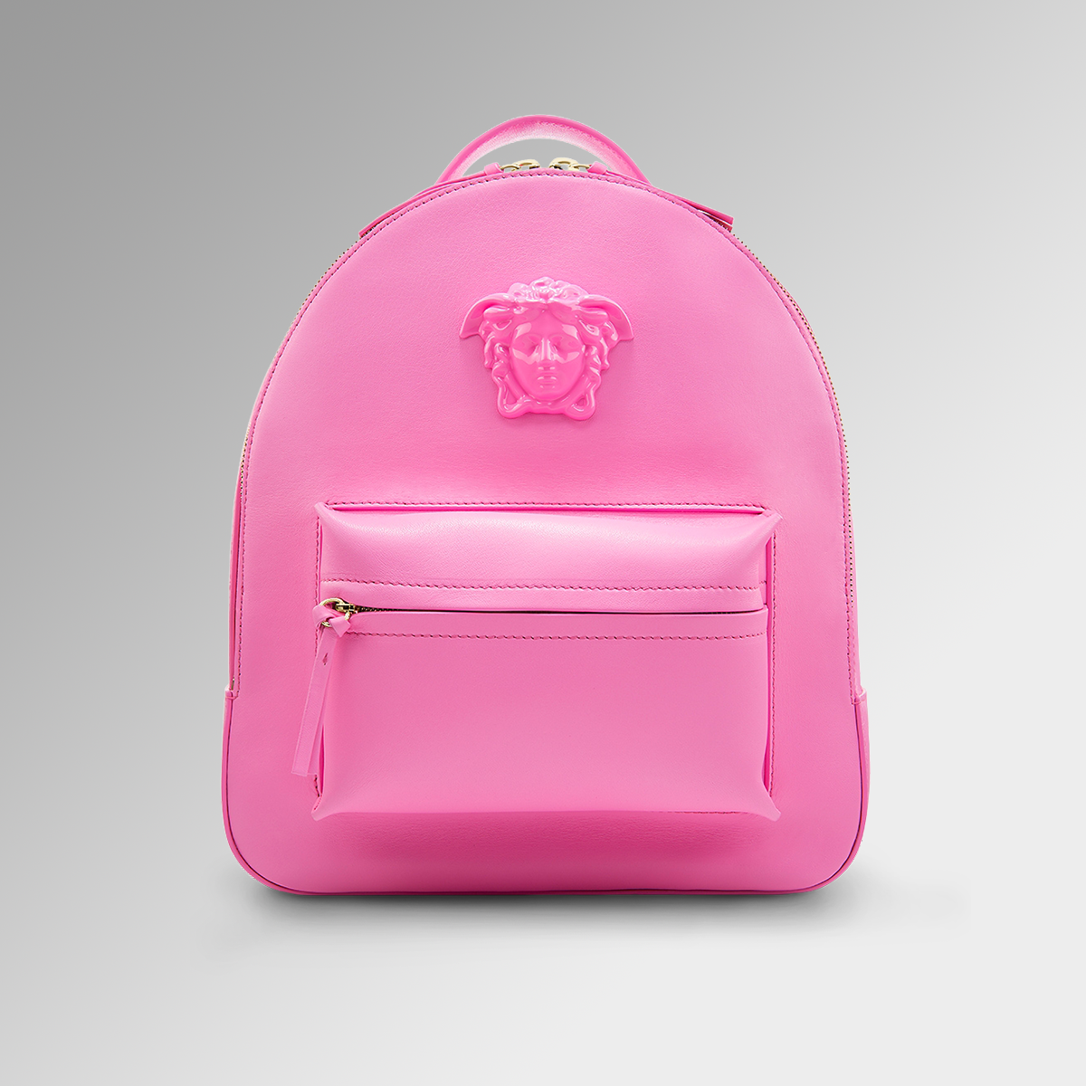 5b7f3809a2ef Be a show stopper with the  Versace hot pink backpack. Find more  Versace  backpacks on versace.com