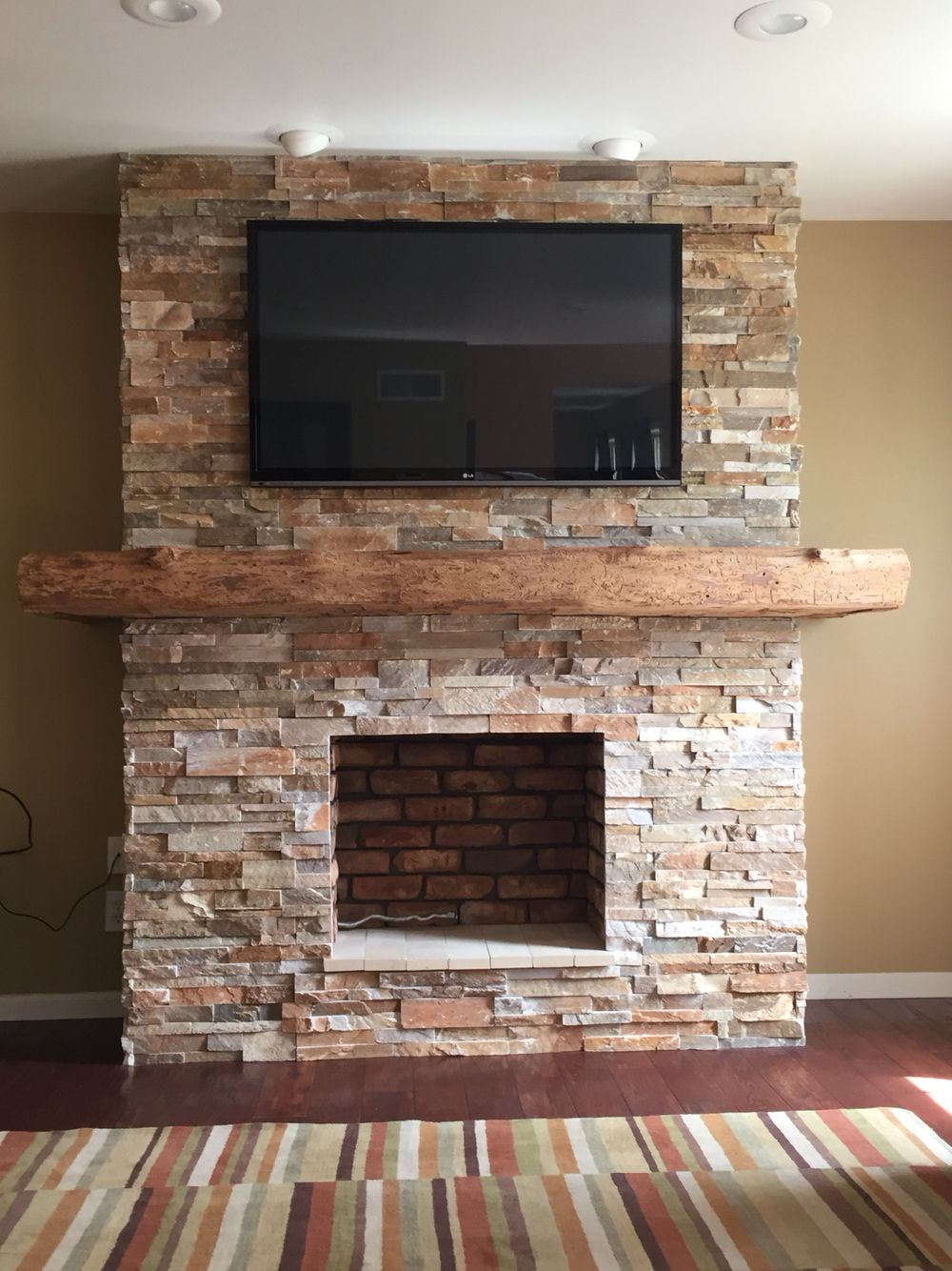 Stone fireplace with wrap around barn beam mantel house - Stone and wood fireplace ...
