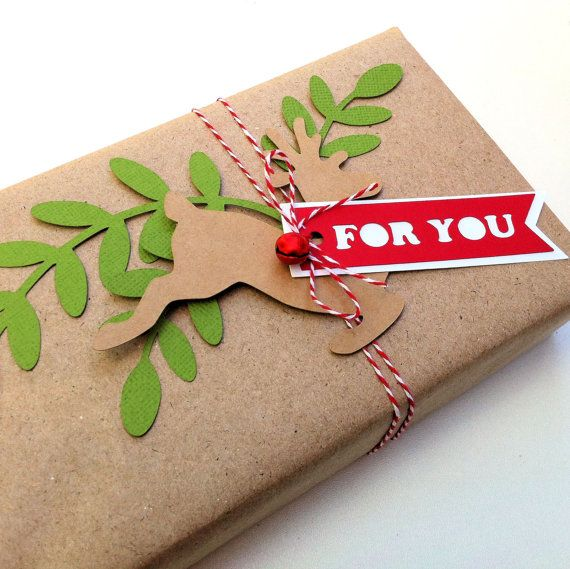 Reindeer Gift Wrapping Tags, gift embellishment. Leaf & reindeer die cuts with gift tags. Rustic Christmas gift wrap. Red, Green, Natural brown kraft. Gift wrapping ideas. Dress up your Christmas gifts with festive embellishments. MyPaperPlanet
