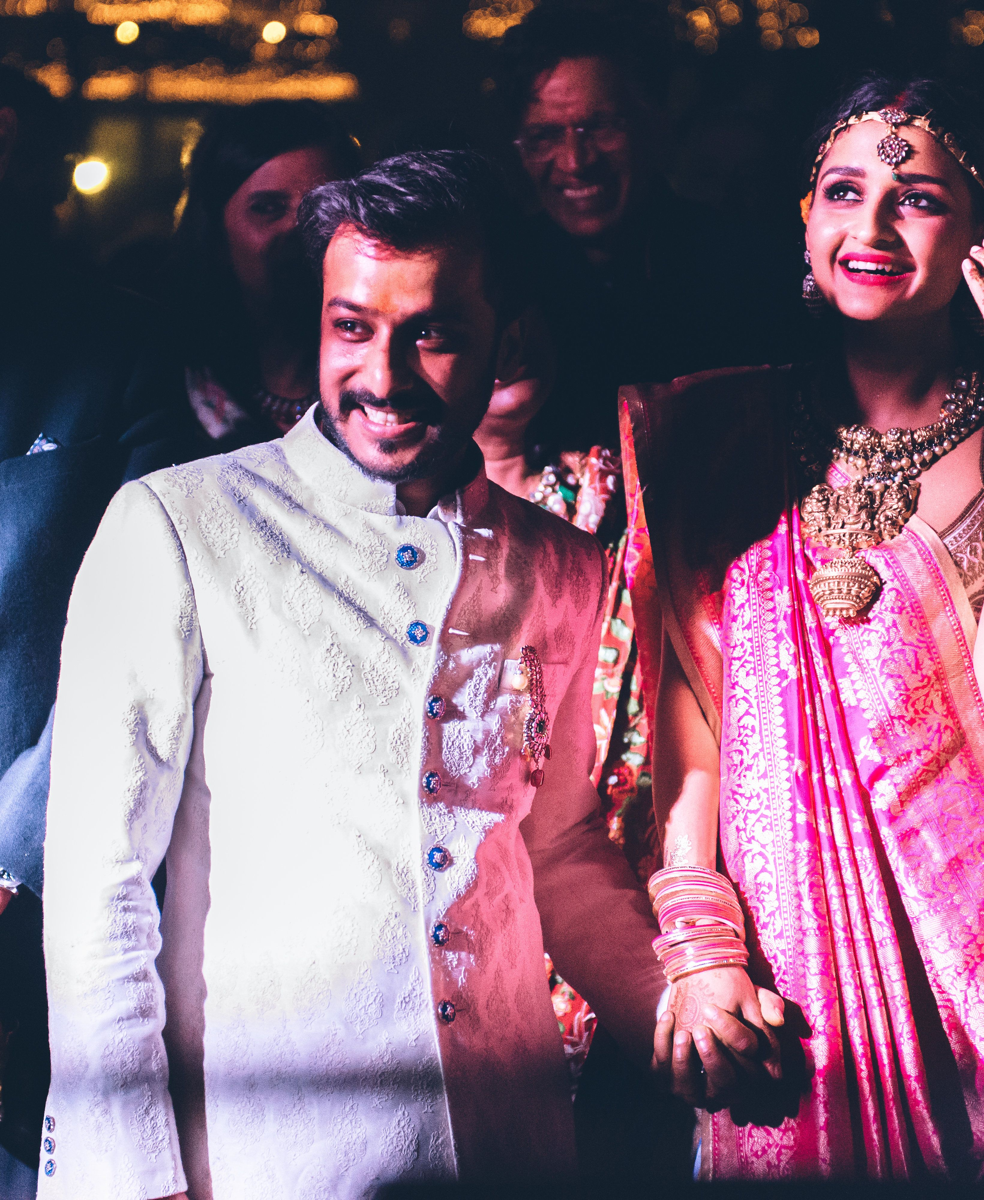 Ashwin wore a paisley jacquard achkan, or knee-length jacket, by Raghavendra Rathore for the wedding. He started the evening wearing a turban with a sarpanch, or turban pin, but when he took it off he pinned the piece to his achkan. The pin was made of rubies, diamonds, and emeralds, and was from the Gem Palace.