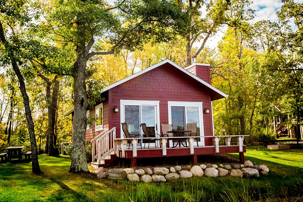 Enjoy a cozy lakefront cabin nestled in the woods around