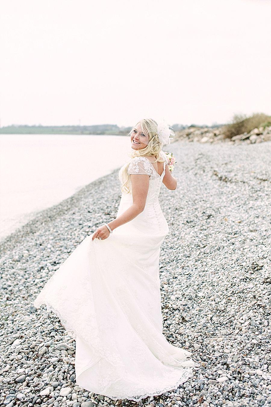rocky beach bridal portrait. destination wedding
