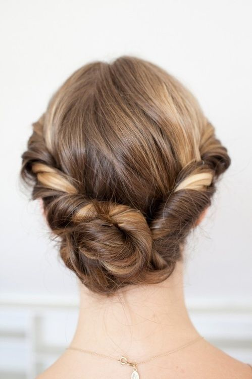 This twist-y updo is perfect for summer days or nights.