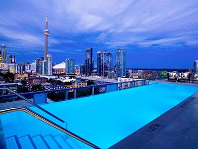 Toronto Condo Rental Rooftop Pool At Night Perfect Pools Rooftop Pool Hotel Pool Toronto