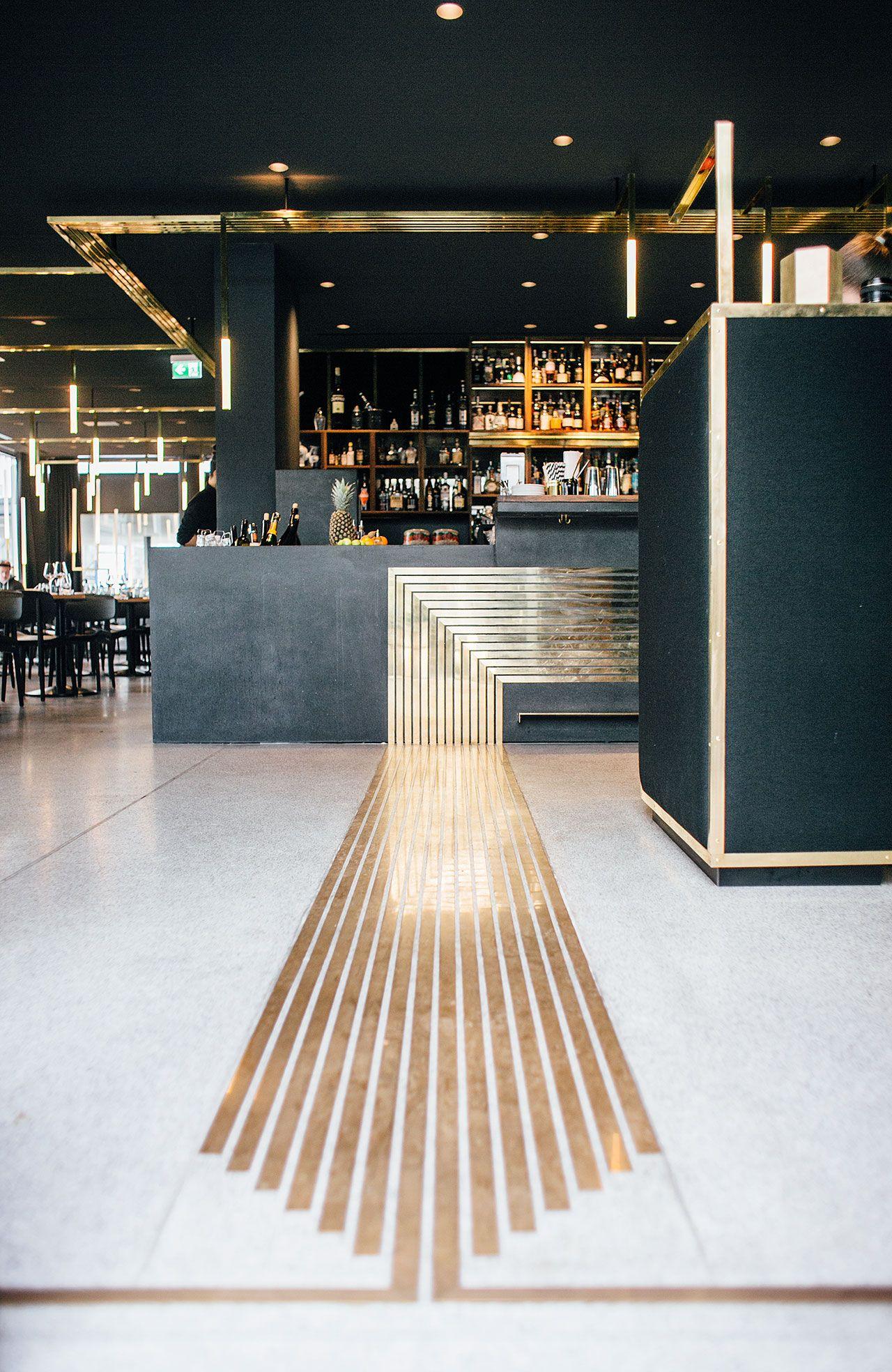 Herzog Bar & Restaurant in Munich with brass veins in the flooring. Photo © BUILD Inc.