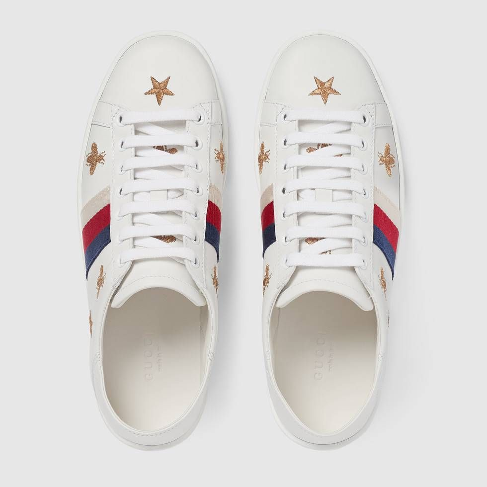 a6837e75520 Shop the Ace sneaker with bees and stars by Gucci. The Gucci bee—a  historical symbol from the  70s archives—is combined with the star motif