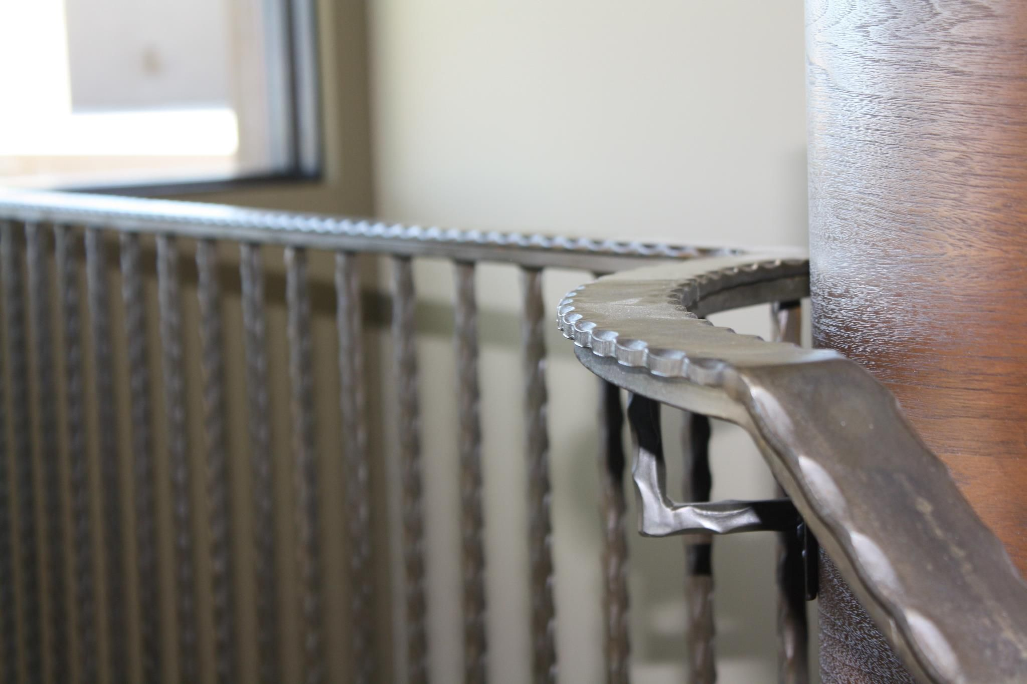 Hammered Handrails And Balusters Give A Simple Tasteful Look To