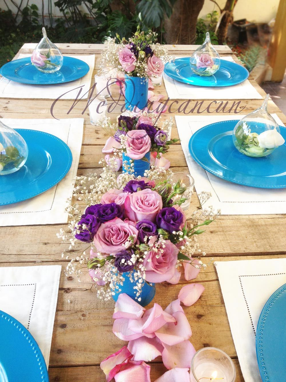 Purple and blue wedding decor  Could have bridesmaids put flowers as decoration  Wedding Style