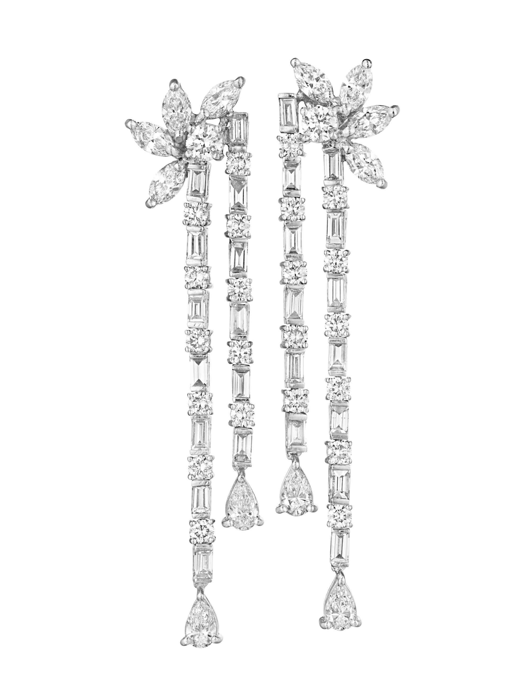 A Pair of Diamond Ear Pendants Each designed as a marquise and circular-cut diamond cluster surmount, suspending two rows of alternating square and circular-cut diamonds, to the pear-shaped diamond terminal, mounted in platinum