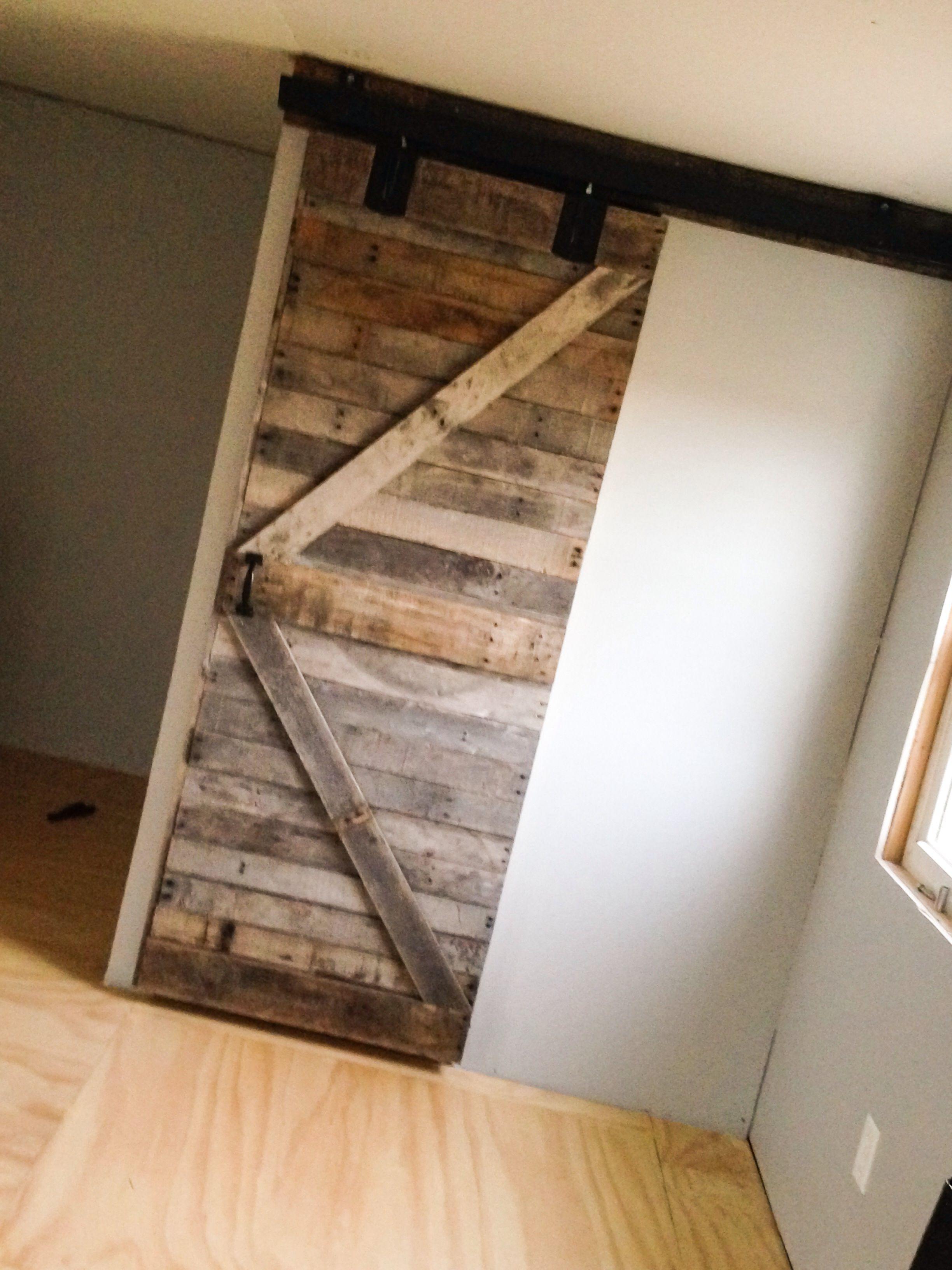My sliding door made of pallet wood pinteres for Diy wood door projects
