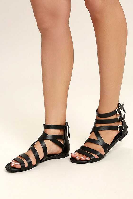 8025ab9b4 Stomp through the festival fields in your new Neria Black Gladiator Sandals!  Vegan leather straps cross over a peep-toe and climb to a cute, ...