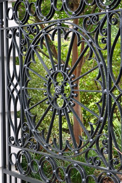 Charleston, South Carolina has tons of these GORGEOUS wrought iron gates, my family told me after they took a trip there last summer.  Mom found a pair of silver earrings for me that are made to look like one of these incredible circular designs.  <3.