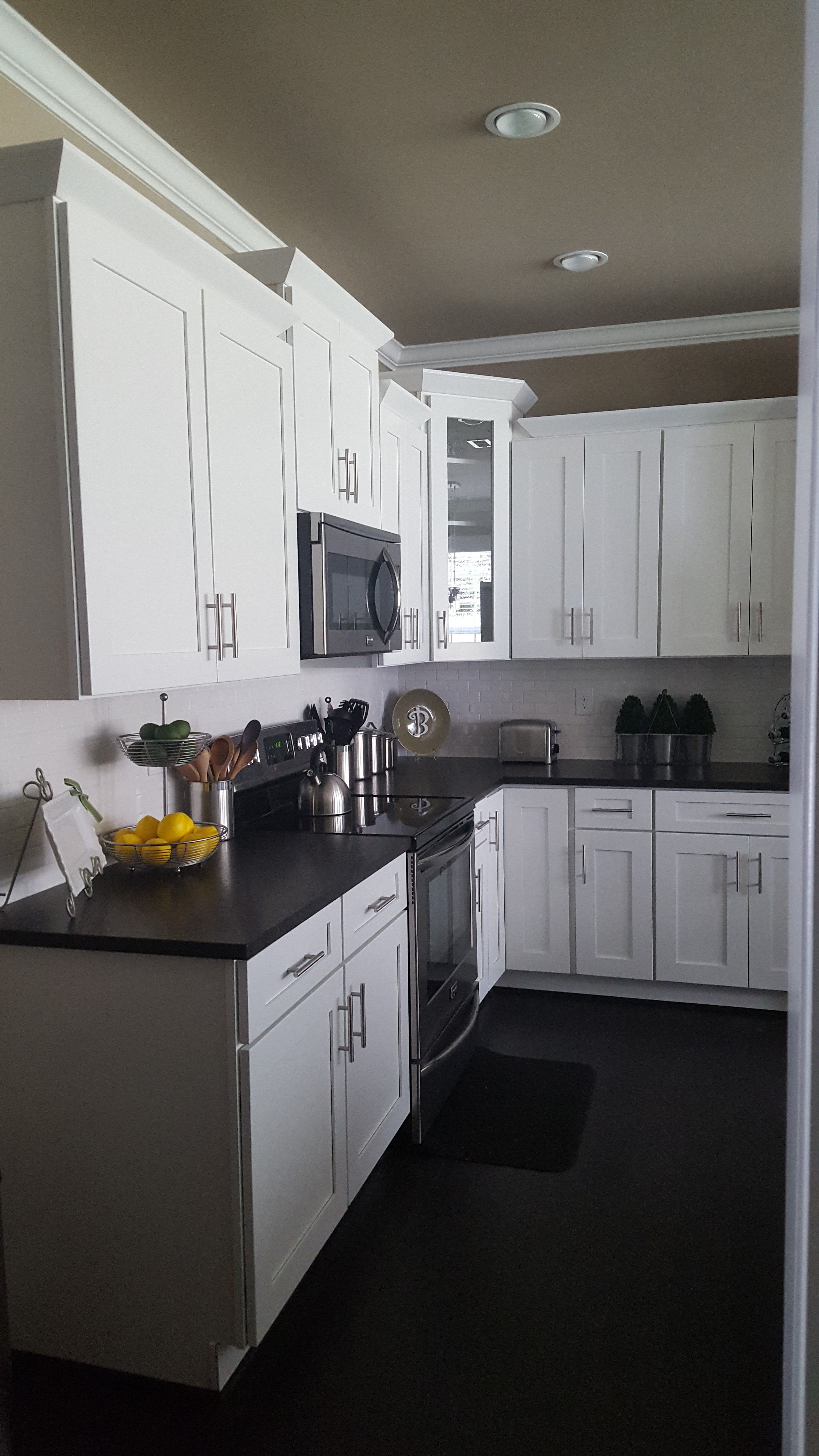 White Shaker Cabinets With Black Pearl Leathered Granite Glossy White Subway Tile And Dark Cottage Kitchen Cabinets Kitchen Design Color Kitchen Design Small