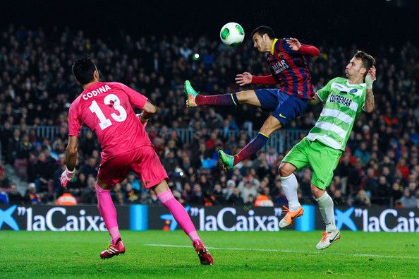 Pedro Rodriguez of FC Barcelona duels for the ball with Alex Ruano of Getafe CF during the Copa del Rey round of 16 first leg match between FC Barcelona and Getafe CF at Camp Nou on January 8, 2014 in Barcelona, Catalonia.