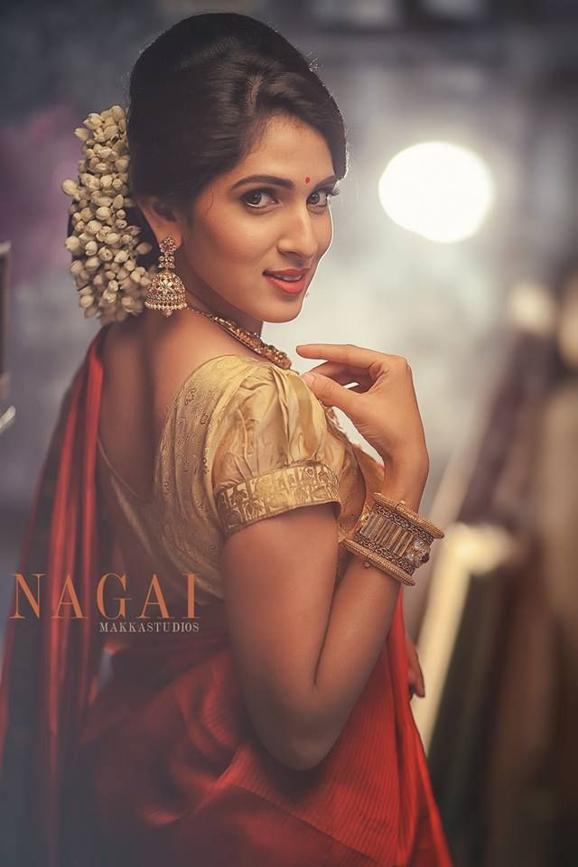 South Indian bride. Temple jewelry. Jhumkis.Red silk sari.Bun with ...