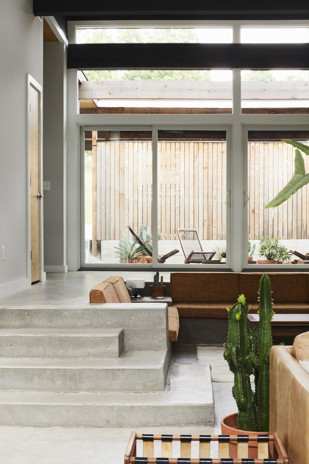 Dwell A Self Taught Designer Builds A Midcentury Inspired Home On A Budget Stairs In Living Room Sunken Living Room Concrete Living Room