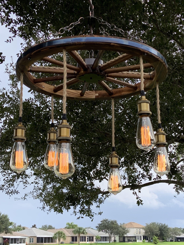 Wagon Wheel Chandelier With Vintage Bulbs Wagon Wheel Chandelier Wagon Wheel Chandelier Diy Mason Jar Chandelier