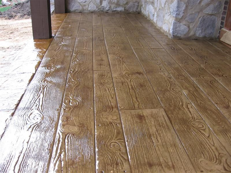 Wrap around porch stained and imprinted concrete cross for Hardwood floor concrete stamp