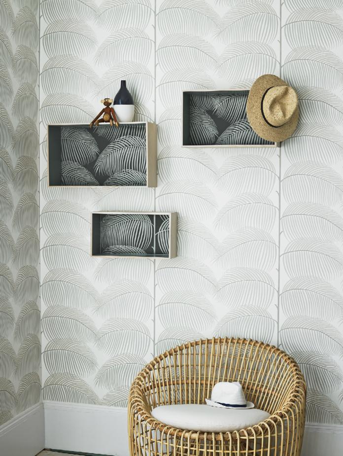 Patterned wallpaper Leaf print Wicker furniture