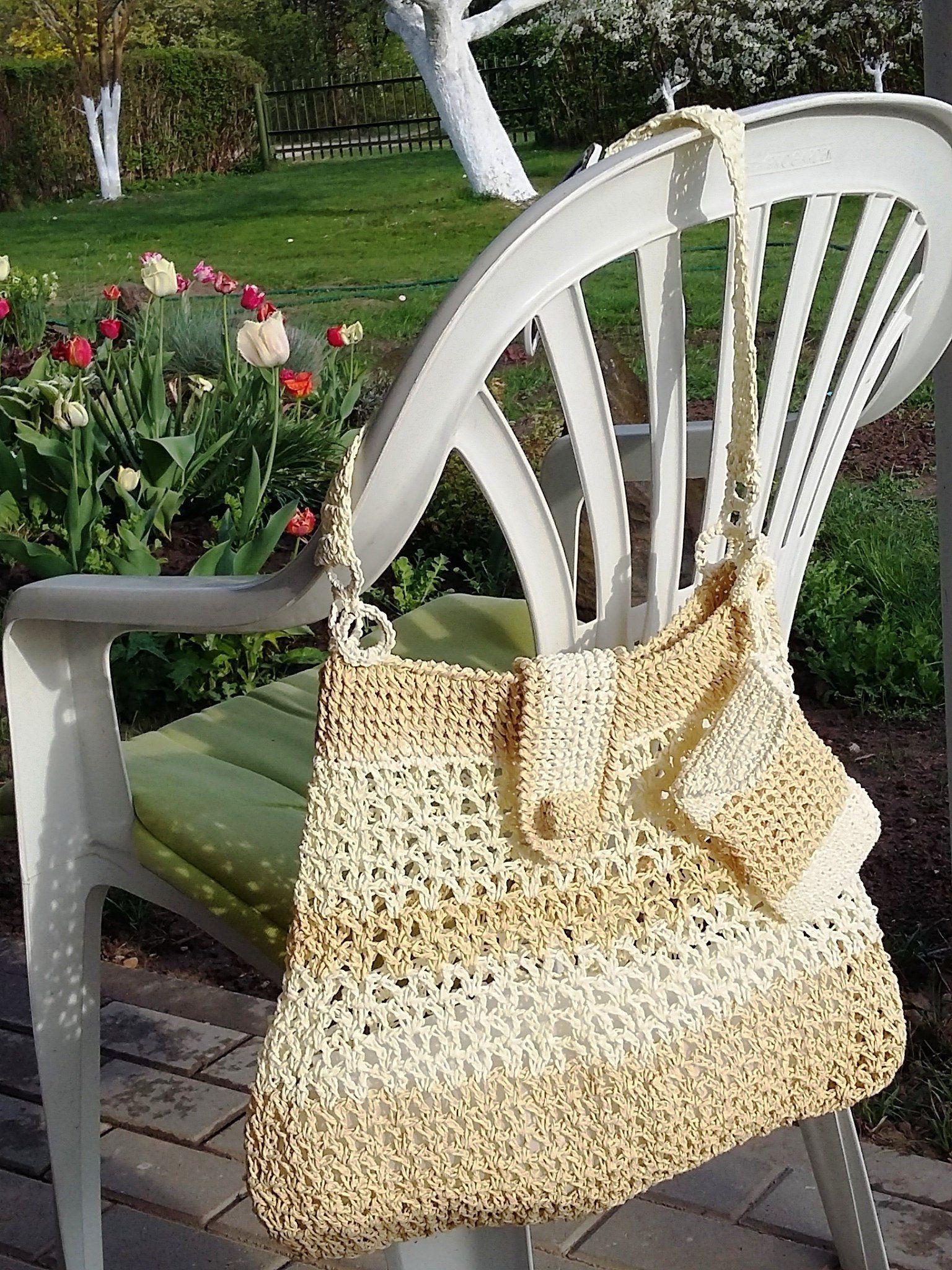Two colors white/beige purse crochet from raffia yarn is a