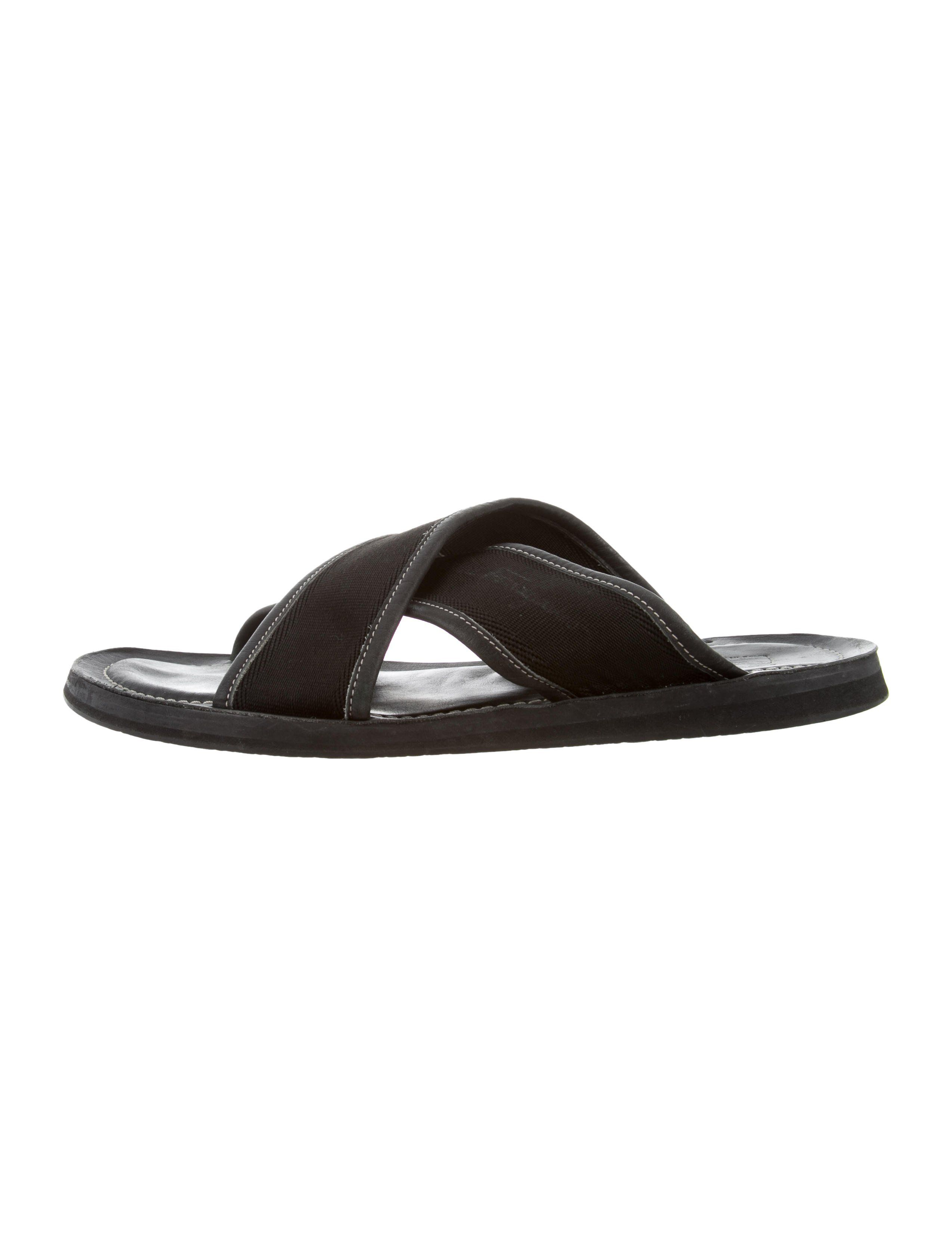 69bc4137e55d Men s black woven and leather-trimmed Salvatore Ferragamo slide sandals  with tonal stitching and rubber soles.