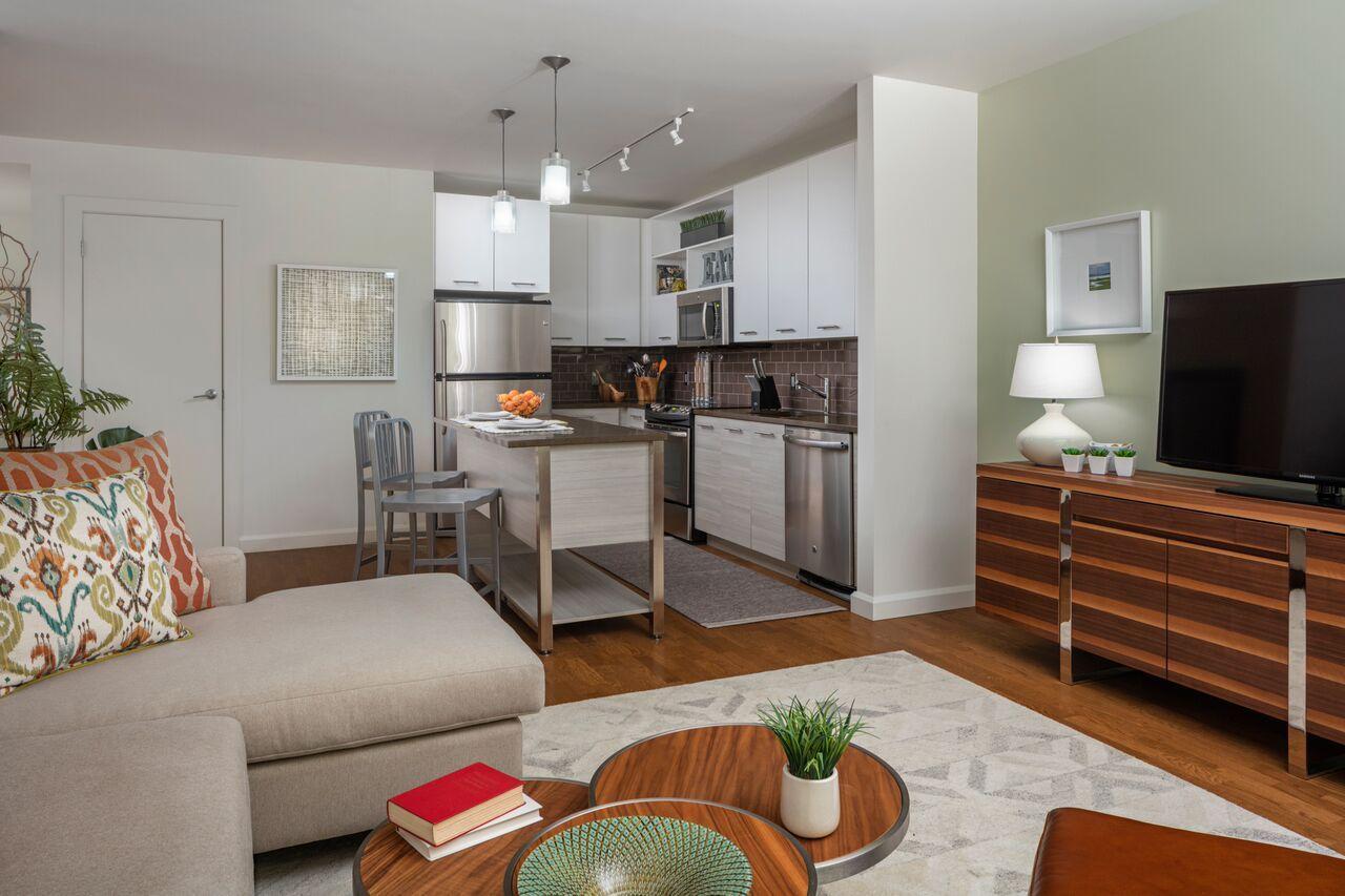 Quaint living room/kitchen setup in this Boston ...
