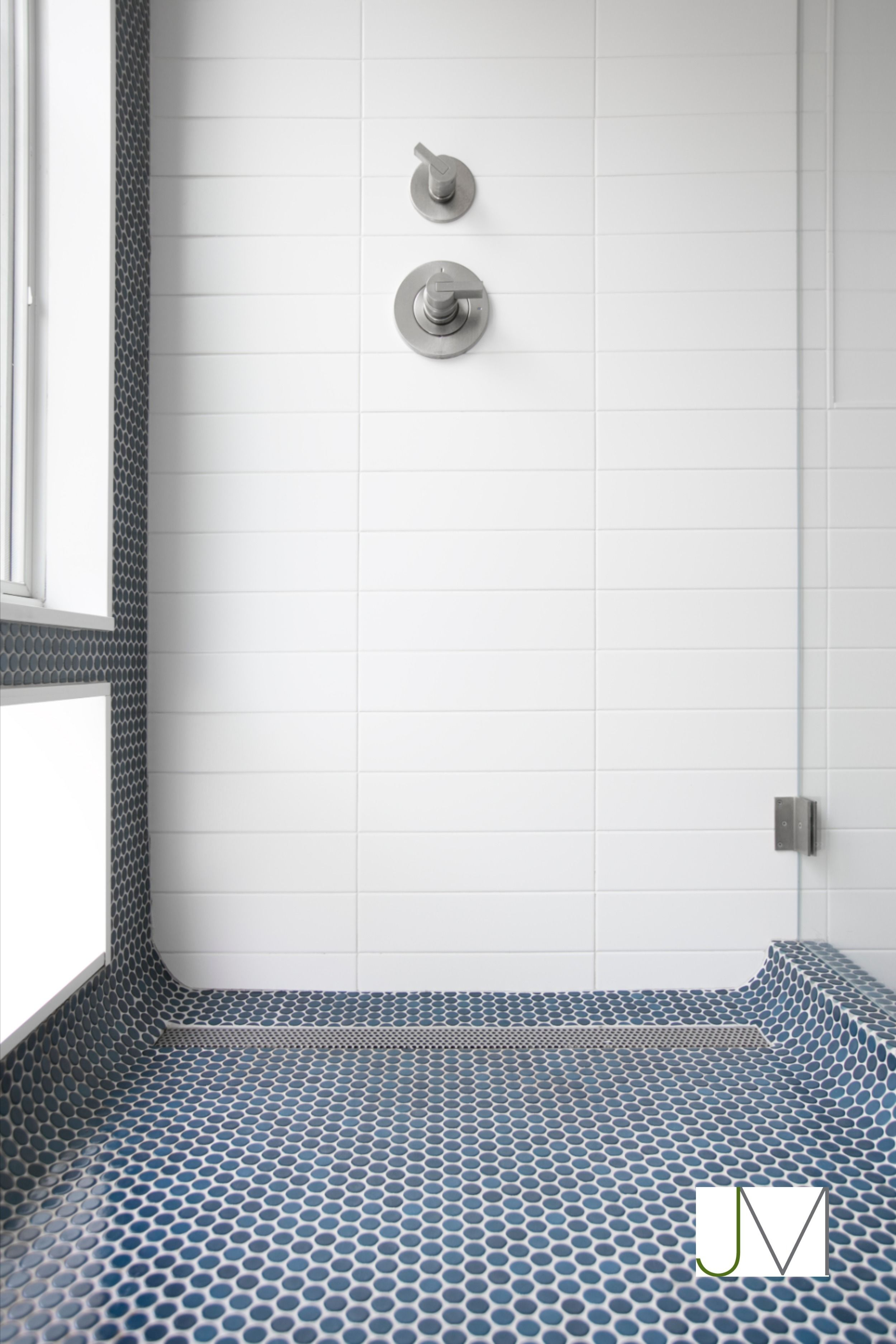 White Shower Wall With Navy Pennytile Accent And Floor Tile In 2020 Small Bathroom Tiles Blue Bathroom Tile Penny Tiles Bathroom